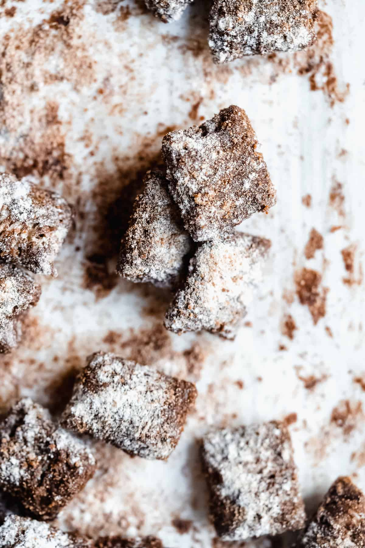 Close up photo of completed Healthy Puppy Chow pieces arranged on white parchment paper.