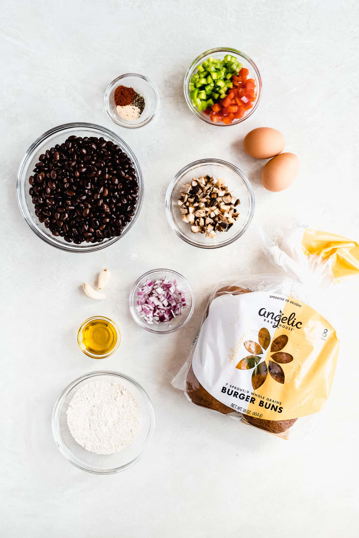 Overhead photo of the ingredients that make up the black bean burger and a bag of Angelic Bakehouse buns.