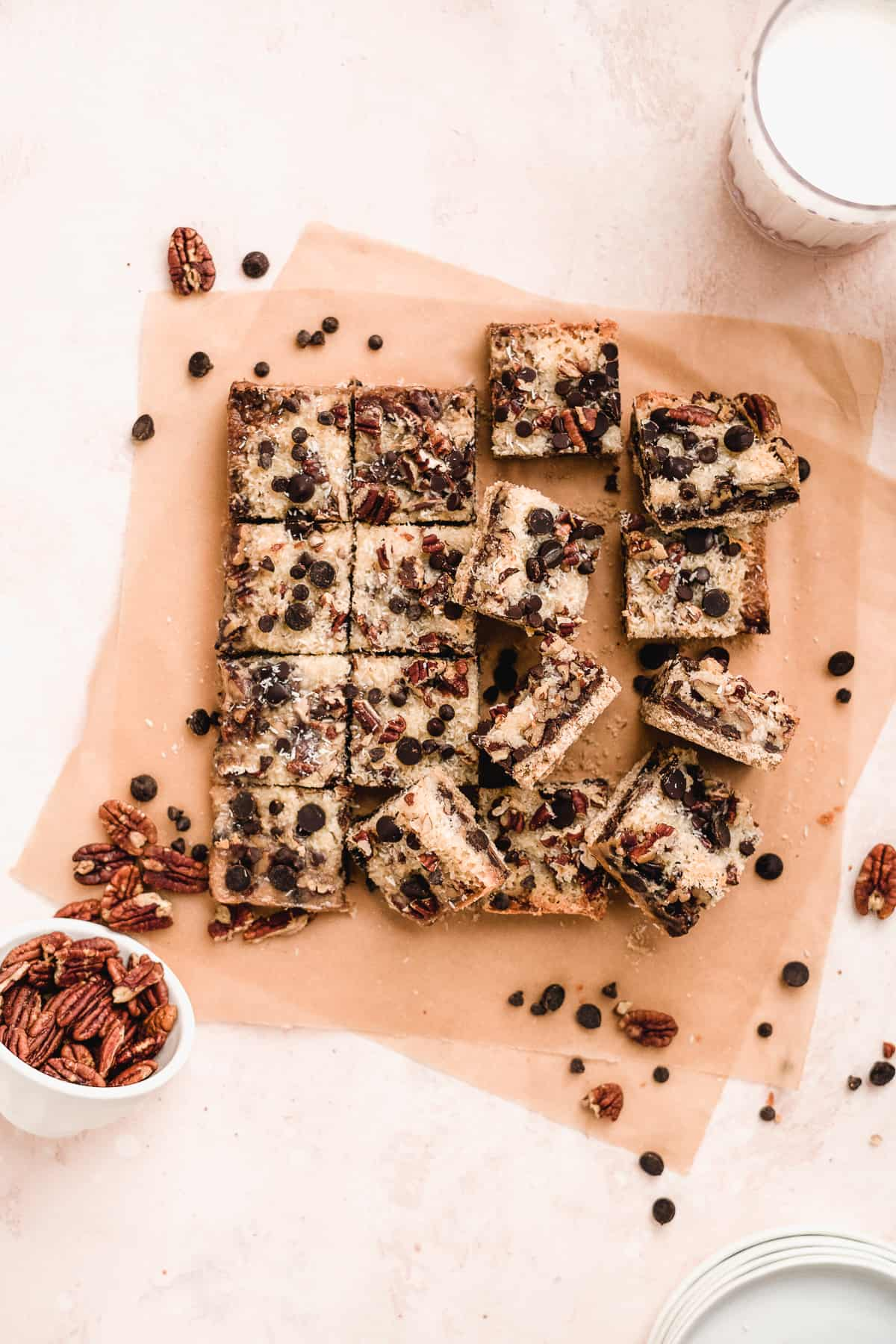 Overhead view of baked Toasted Oat Seven Layer Magic Cookie Bars cut into squares and separated to reveal the delicious side and top views.