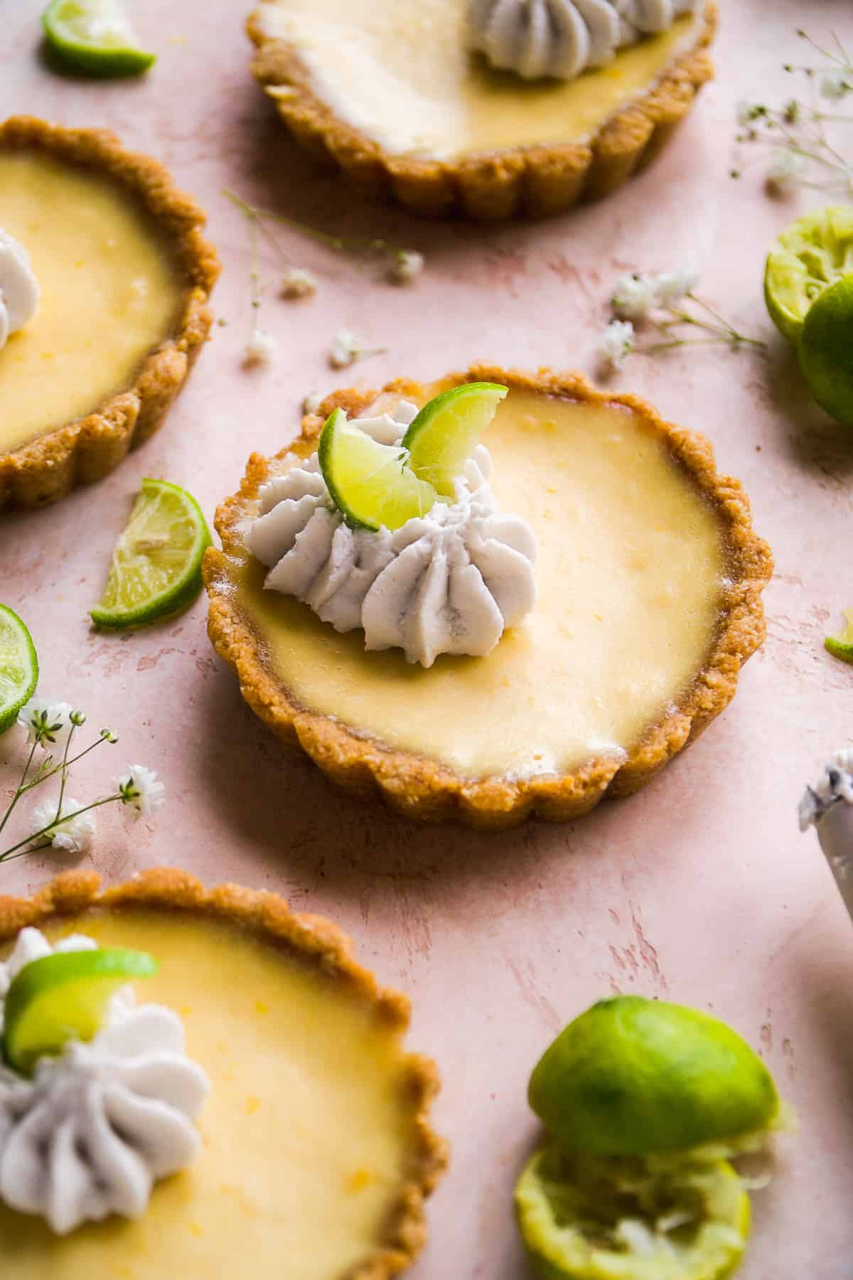 Gluten free key lime pie tarts with whipped cream.